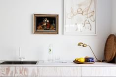 RIAZZOLI blog. You can barley tell this is even a kitchen. Lovely joinery and paintings hung in the kitchen all an inspiration...