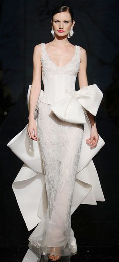 Fausto Sarli couture gown in winter white.  Amazing oversized bow and small train.  Classic beauty!