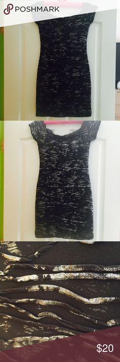 Black and silver night dress Medium black dress with silver streaks. Very cute and great material. Dresses Mini