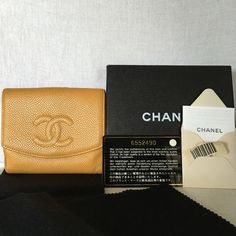 Not for sale This is authentic Chanel wallet in camel. Chanel signatur Caviar skin leather....buttery soft inside and out. Coin pocket with CC logo flap outside, 6 card slots, two pockets and one bill compartment. A dime size water stain where by the made in Italy gold stamp....coin pocket is darkened by storing coins...the photo shows the true conditions please check each photos carefully. No loose stitches...still in good condition. Everything you see in the photo comes with your purchase…