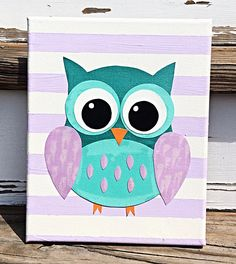 Super cute owl made out of paper, paint and some sparkles just for that added cuteness!  Wouldn't this be a great addition to a nursery or little girls room?