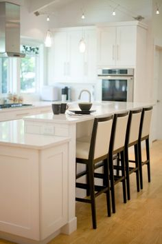 Close-up image of the two level island designed by Cathy of Auer Kitchens Photo by Bealer Photographic Arts