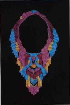 136. Royal Pectoral. This bold pattern is somewhat more complex and does not require beads. The strong geometric pattern is shown to advantage with the striking colors used in the sample. Necklace by Helen Banes.