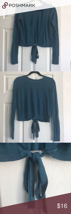 EUC Teal Open Back Sweater by Abercrombie & Fitch Beautiful and unique long sleeve sweater. Open back sweater that ties into bow and a connecting piece to keep it closed too. Could probably be worn turned around with a cami as well. Pretty dark teal color. Brand is Abercrombie and Fitch. Size small. Machine washable. Feel free to make a reasonable offer. Not sure what's reasonable? Check out the chart at the top of my closet. ☺️ Abercrombie & Fitch Sweaters