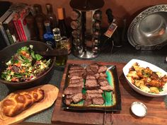 Filet mignon, roasted potatoes, loaded salad and challah.