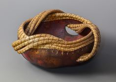 """""""In and Out"""" gourd, pine needle, waxed linen thread, leather dye 8 inches diameter $125 ©Toni Best"""