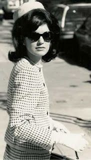 With her pillbox hat, tailored/skirted suits, pearls, sunglasses and classic designer shoes, First Lady Jacqueline Kennedy quickly became a world-wide fashion icon.   #fashion #vintage #JacquelineKennedy #photography