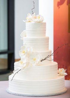 White Wedding Cake with white Orchid's                                                                                                                                                                                 More