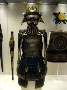 """1500s-1800s Samurai Armour at the British Museum, London - From the curators' comments: """"The armour is a collection of different pieces made between 1500 and 1800. The small metal plates are tied with silk, and protect against arrows. In the 1500s the Portuguese brought guns to Japan and a thick bullet-proof metal breastplate has been added. A grimacing metal mask and 'horns' on the helmet instill fear."""""""