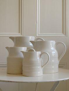 white pitchers - I can imagine some sort of botanical inside them.