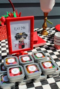 Tin treats at an Alice in Wonderland Birthday Party!  See more party ideas at CatchMyParty.com!