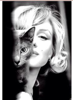 Marilyn Monroe and her cat.
