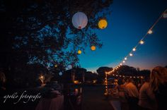 Light up lanterns that line the reception  paired with old school bulbs... so chic.     www.ApolloFotografie.com
