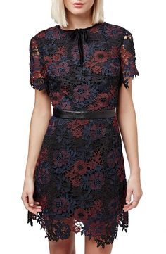 Rich floral lace and a velvet tie-neck sweeten the look of this short-sleeve Topshop overlaydress that would be paired perfectly with black pumps.
