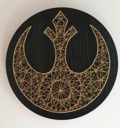 Star wars string art with gold thread and black stained Oak veneer