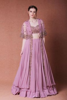 Featuring a set of lilac lehenga and a long cape with a detachable strappy blouse in georgette base. Cape and blouse are embroidered with bugle beads, dabka, sequins and pearl beads in a floral pattern. Color: Purple Material: Georgette,net Dry clean only Party Wear Indian Dresses, Designer Party Wear Dresses, Indian Gowns Dresses, Indian Fashion Dresses, Dress Indian Style, Indian Wedding Outfits, Indian Designer Outfits, Pakistani Dresses, Indian Outfits