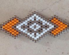 Items similar to Miyuki Necklace-Geometric -Triangle on Etsy Beaded Cuff Bracelet, Peyote Beading, Beaded Jewelry, Art Perle, Native American Beadwork, Peyote Patterns, Bijoux Diy, Beading Projects, Seed Bead Tutorials