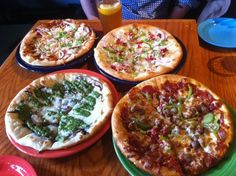 Fly Bar & Restaurant - Happy hour - noon to 6:30 (except Mon.) Half off Pizzas. 3 dollar draft beers.