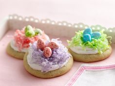Easter Nest cookies...make your favorite sugar cookie recipe, and use this idea...colored shredded coconut and jelly beans or robin's eggs.