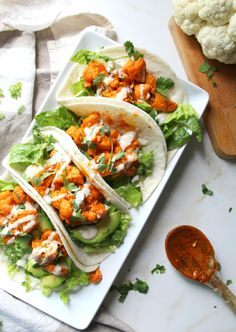 These Vegan Buffalo Cauliflower Tacos are packed full of spicy buffalo sauce, creamy ranch, crunchy romaine and hearty avocados.