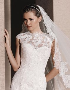 Ridal WEDDING DRESSES 2016 Petit pois tulle dress with Chantilly lace and thread embroidery appliqués. Bodice with sweetheart neckline. Lace bolero with crew neck.