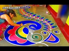 Diwali Special full floor Big Peacock Rangoli designs by Art Gallery Rangoli Designs Peacock, Rangoli Designs Simple Diwali, Simple Rangoli Border Designs, Indian Rangoli Designs, Rangoli Designs Latest, Free Hand Rangoli Design, Small Rangoli Design, Rangoli Patterns, Colorful Rangoli Designs