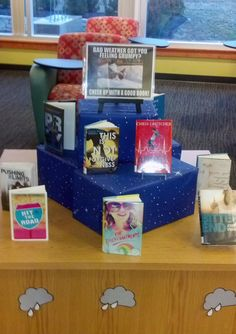 """Grumpy Cat Library Book Display """"Bad Weather Got You Feeling Grumpy? Cheer Up With A Good Book!"""""""