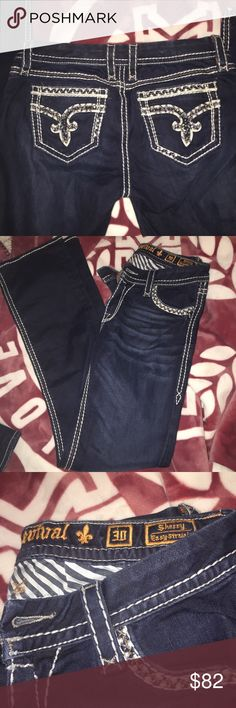 ROCK JEANS ⭐️TRADE ?⭐️ Size 30 lots of bling absolutely no flaws. Tried on once. Inseams 32/33 Sherry straight ... Wanting sell or $110 trade value Rock Revival Jeans