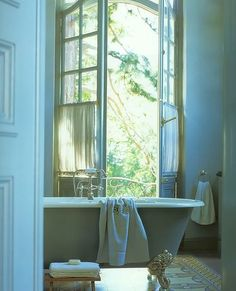 the mermaid bathroom actually does have a door to the garden, but not pretty french doors like this... hmmm.