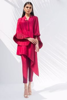 RAW SILK ASYMMETRICAL KURTA and pants Simple and refined, this red Raw Silk ensemble with ruffled sleeves and asymmetrical hemline is perfect for evening activities. * Plain Raw Silk pants All orders would take a minimum of 15 to 20 working days Simple Pakistani Dresses, Pakistani Fashion Casual, Pakistani Dress Design, Indian Fashion, Kurti Sleeves Design, Sleeves Designs For Dresses, Sleeve Designs, Indian Designer Outfits, Designer Dresses