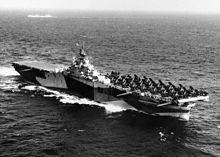 USS Bennington (CV-20) underway during her shakedown, in the western Atlantic or Caribbean area, 20 October 1944. She is painted in camouflage Measure 32, Design 17a (No. 1).