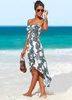 Perfect for a quick cover up for a stroll on the beach of add some chunk jewelry and heels and wear it out for dinner. Strapless print dress in the VENUS Line of Dresses for Women