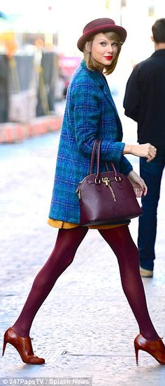 Getting it right:The 24-year-old made sure to show off her incredibly long legs in maroon stockings and a mustard coloured mini-dress