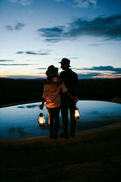 Couple , sunset , the darkness and the lamps