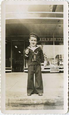 vintage child in a navy uniform, sailor boy!