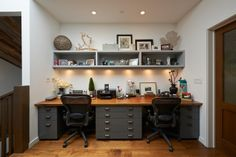 home office - two office spaces desk made of filing cabinets and wood