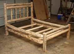 """White cedar """"Lodge"""" style full bed with short foot board."""