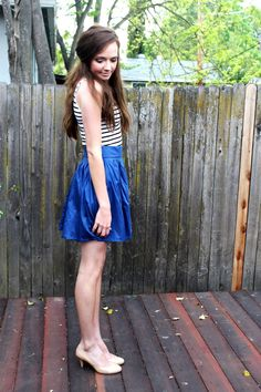 striped top and blue skirt