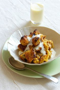 Pumpkin Bread Pudding with Vanilla-Rum Custard- It doesn't get much cozier than a piping bowl of the Challah-based dessert topped with rich homemade sauce. Get more pumpkin dessert ideas at redbookmag.com and click through for the full recipe.
