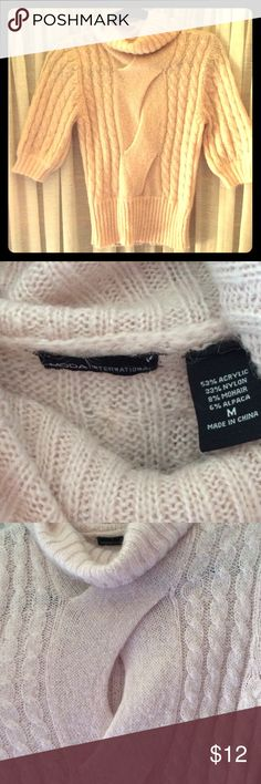 Moda International turtleneck keyhole sweater M Moda International light pink turtleneck cable short sleeve front keyhole sweater size M.  Pre-owned, excellent condition.  53% acrylic, 33% nylon, 8% mohair, 6% alpaca. Moda International Sweaters Cowl & Turtlenecks