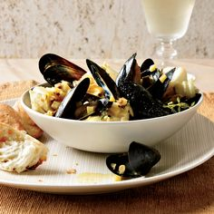 Chef Way Alain Ducasse cooks mussels, then removes the top half of each shell before serving them with haddock and a curry sauce with mussel jus.  E...