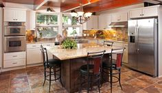Michels Homes Mid Century Modern Kitchen Remodel Featuring Dura Supreme Cabinetry Granite Countertops And Tile Flooring