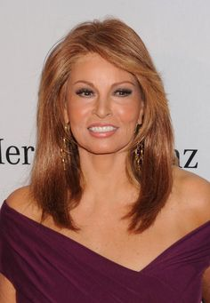 Raquel Welch still hot at 70 even though it looks like she may have on a lacefront wig.