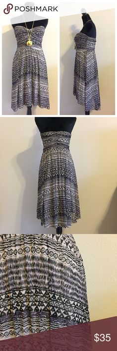 Free People Hi Lo Strapless Dress Gorgeous gauzy dress from FP! Strapless. Has sticky strip to help hold it up. No zipper; elastic. Small spots on inside of dress (the Lo part of the Hi Lo). Black/gray/purple. No trades. Necklace not for sale. Free People Dresses Strapless