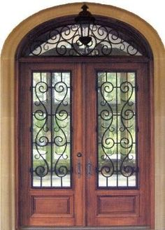 Wrought iron double front doors...Tuscan style. We are getting these 8' double doors (no window accent above. The transom window will be a little higher up. <3