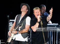 Joe Don Rooney and Gary LeVox of Rascal Flatts perform at Rascal Flatts Rhythm and Roots Tour at Nikon at Jones Beach Theater on September 1, 2016 in Wantagh, New York.
