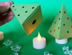 Three ways to enjoy this item: - Put ON TOP of your battery operated tea light (picture 2 & 3) for a classic Christmas tree look - Put your battery operated tea light candle INSIDE the box for a modern Christmas tree Decor (picture 1) - Put your favorite treats inside to serve as a mini gift box / favor box. Size: 3.6 high base of the box 2.4x 2.4 This listing is for 6 of the Green tree shaped boxes (Candles are not included) If you would like the LED candles to go with your trees, ...