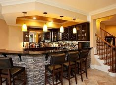 Like the stone accent on this custom basement bar. | http://www.homechanneltv.com/photos-basements.html