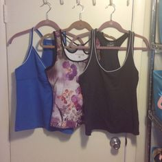 Trio Of Workout Tops Size Large Gently worn 3 workout tops. The light and dark blue a both old navy. The purple floral is Avani. Lots of life still left in them. Old Navy and Avani Tops