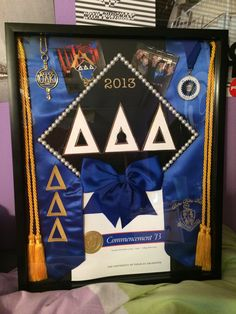 -Maybe a good idea for Caitlin college grad--Graduation shadow box for next year! With Theta stuff! ✨